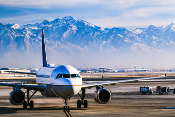 Salt Lake City International Airport with snow-covered mountains backdrop